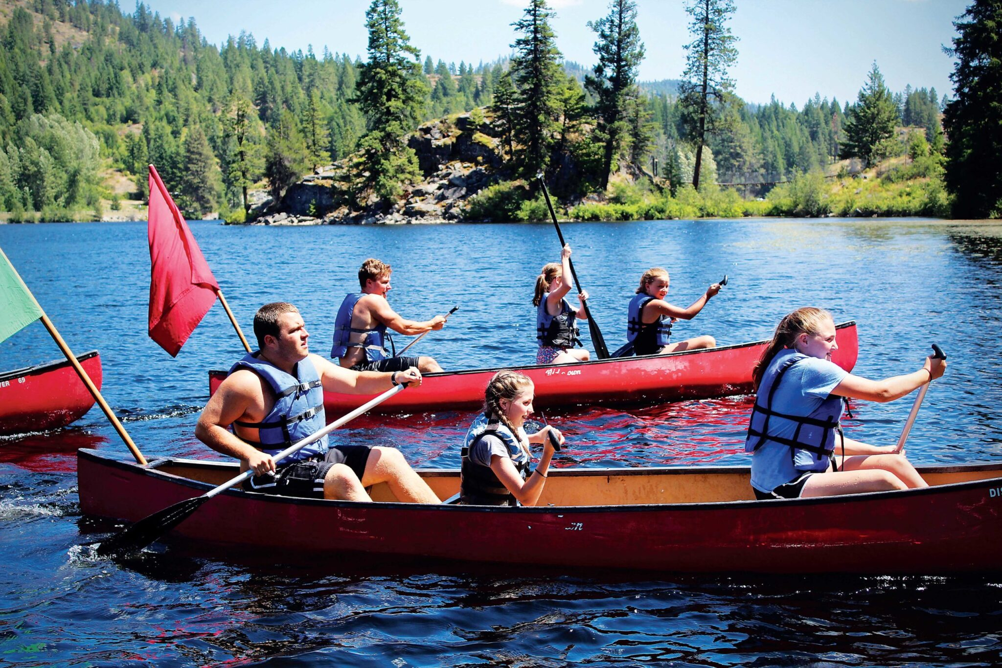 A group of kids canoeing.