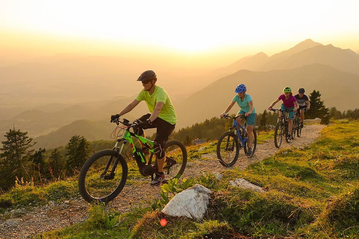 A group biking on a mountain trail.