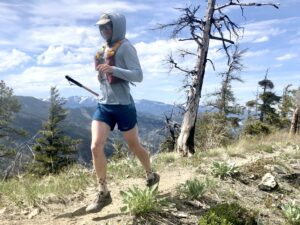 A person running on a mountain trail.