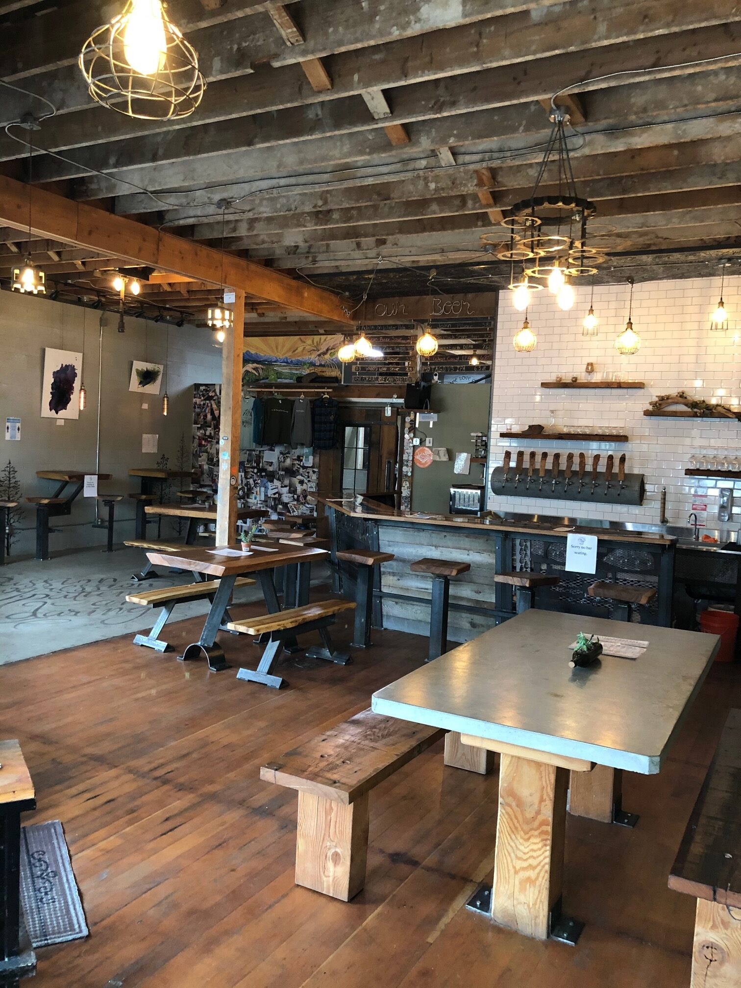 A brewery storefront with exposed ceiling beams.