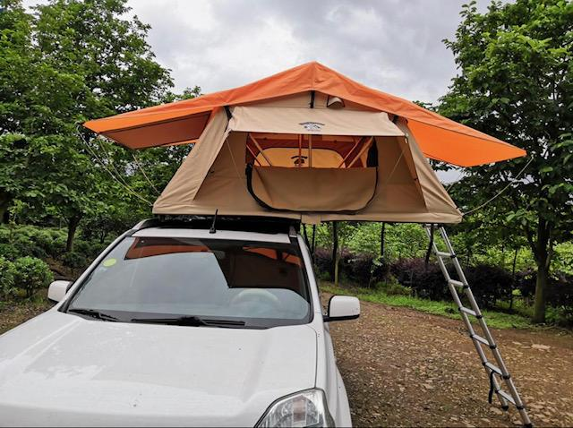 A car roof mounted tent.