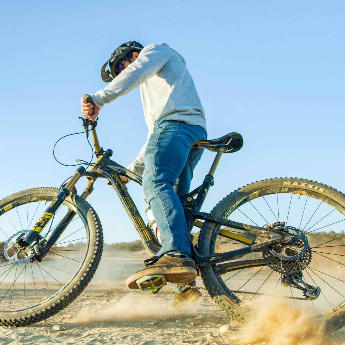 Man skidding through dirt.