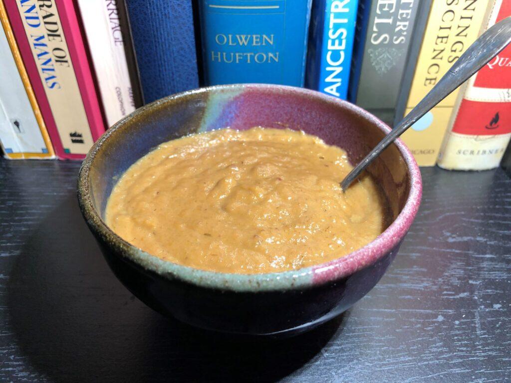 A bowl of thick tan/brown soup.