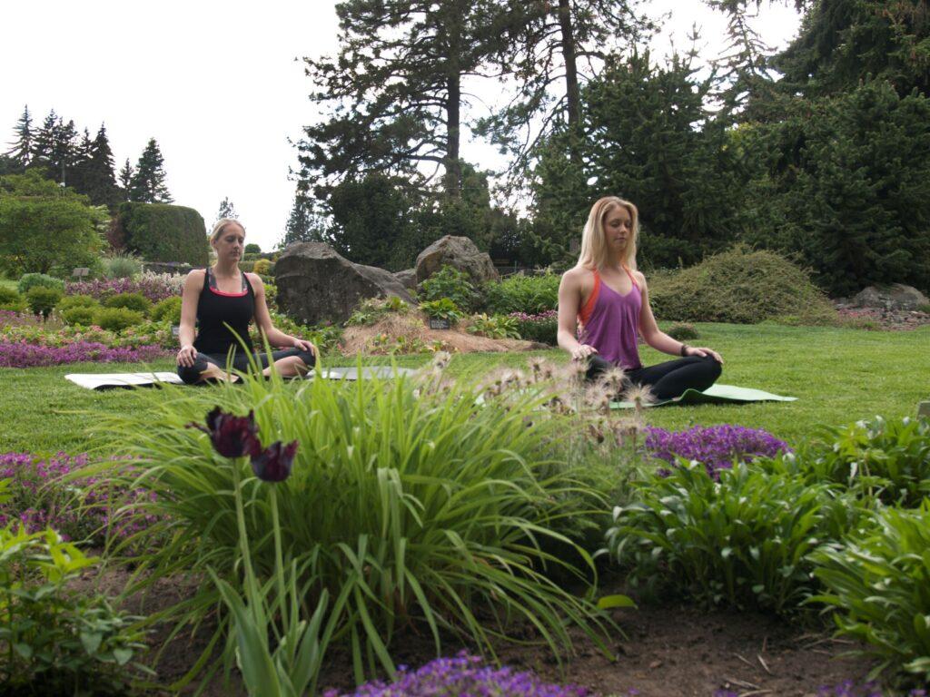 Two women doing yoga meditation.