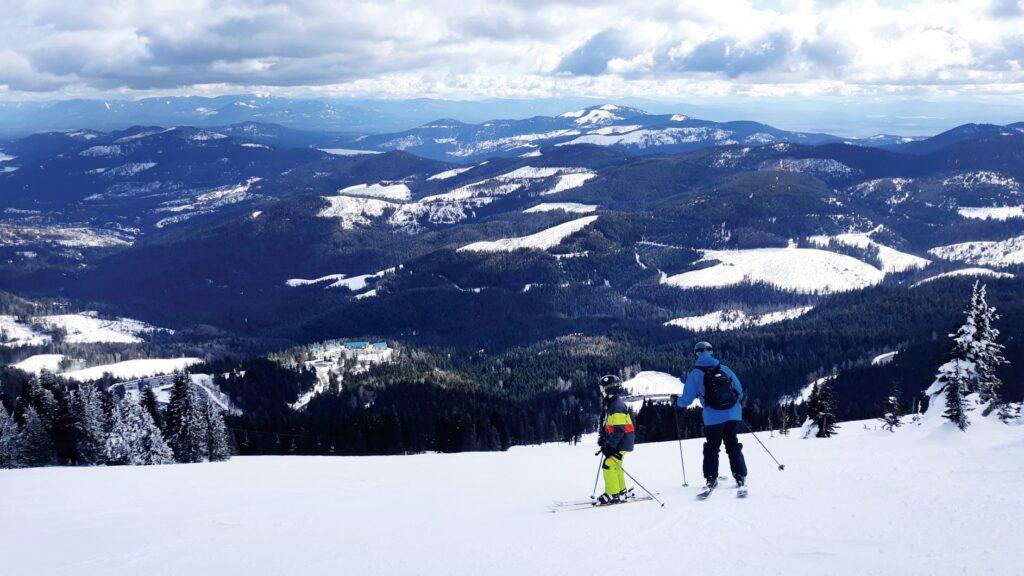 Family skiing down Mount spokane.