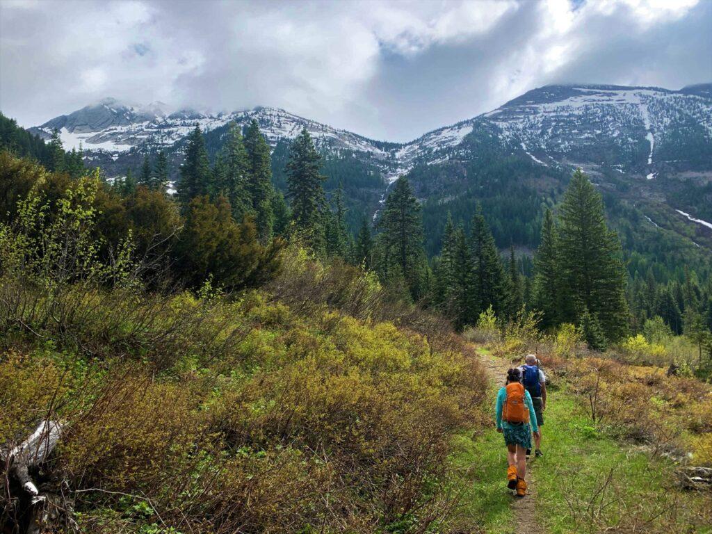 Family hiking through mountains.