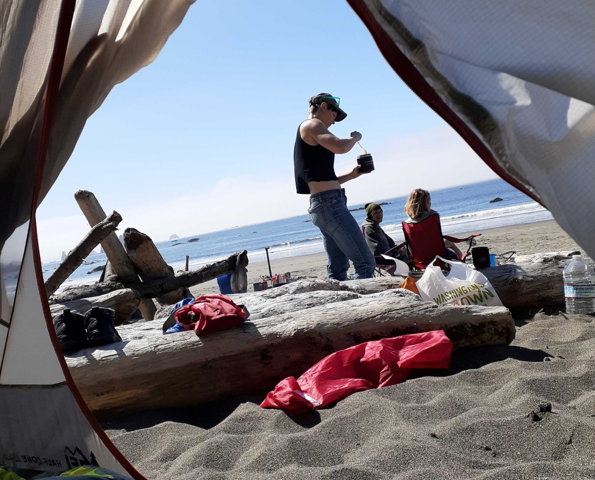 A family camping on the beach.