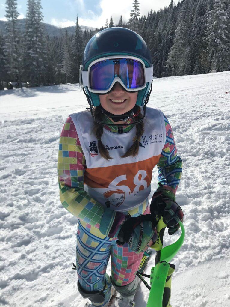 Ski racer smiling.