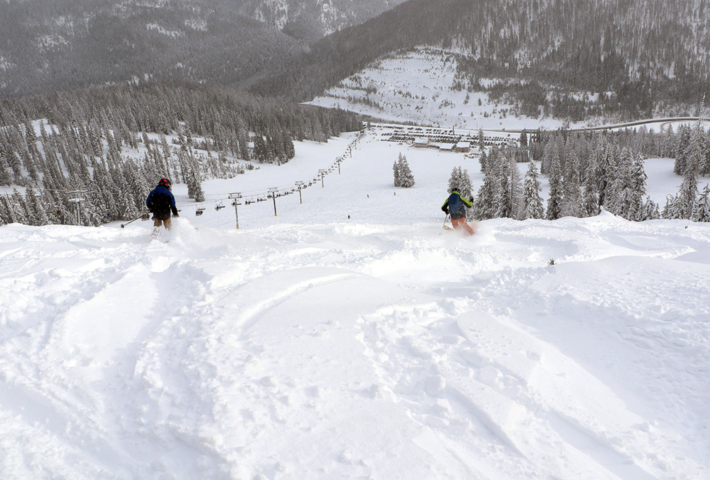 Deep powder on the Idaho side of Lookout Pass Ski & Recreation Area, leading down to the lodge.