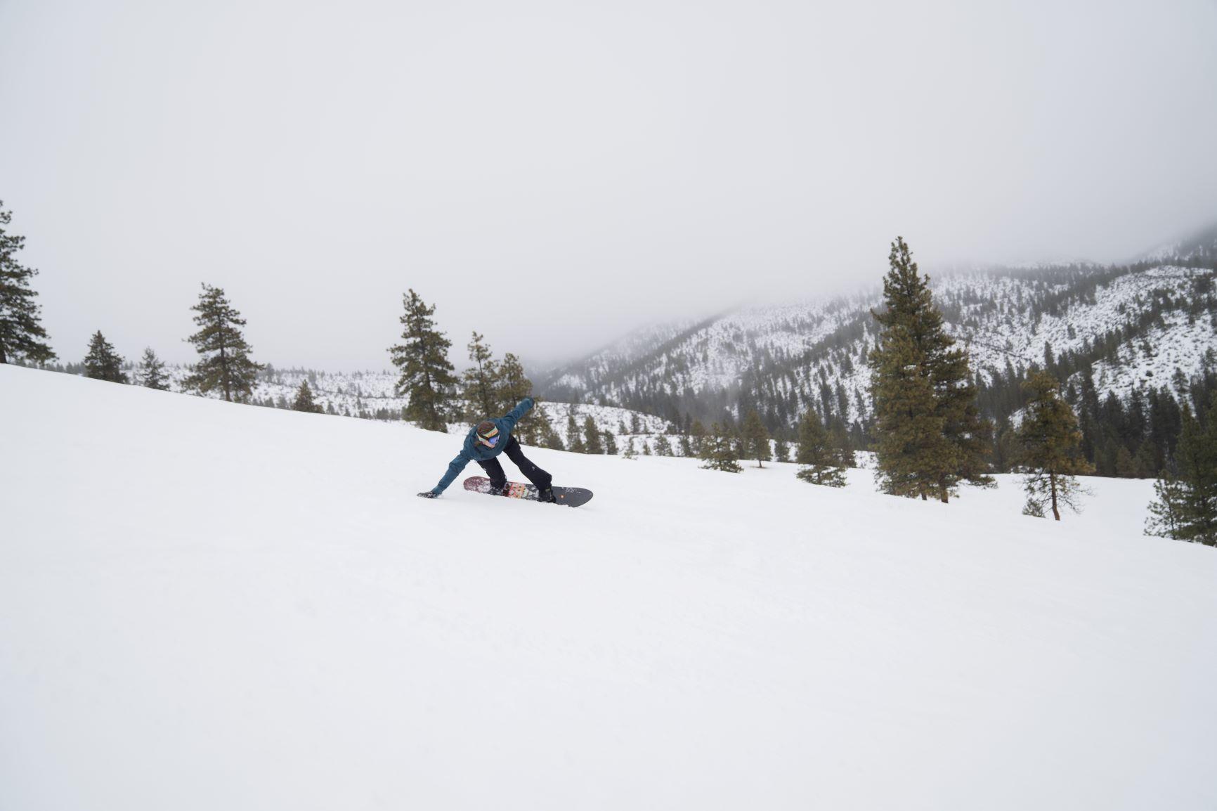 Person snowboarding down echo valley ski hill.