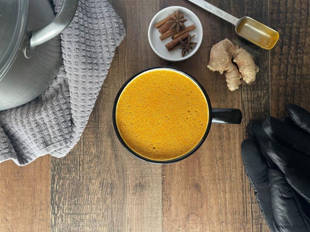 Bird-eye view of golden milk and ingredients.
