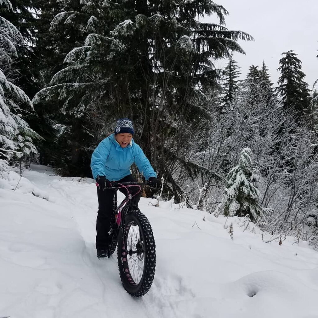 Jane Huang riding a fat bike.