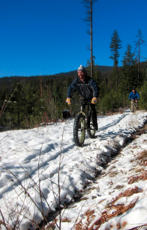 Biking over snow with fat tires.