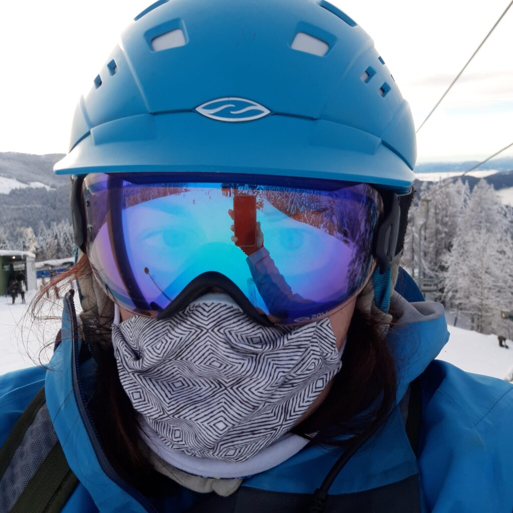 Person taking a selfie showing off their ski mask and helmet.