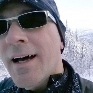 Brad Thiessan's profile of them wearing sunglasses on winter hike.