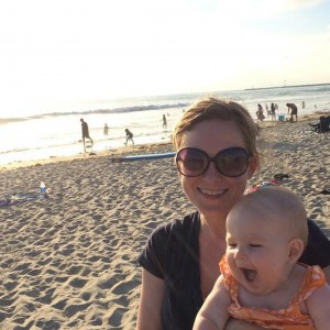 Sarah Hauge profile of her and her daughter on the beach.