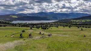Bikers along a windy dirty trail on the Saltese Uplands area in the city of Liberty Lake, Washington.