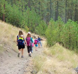 Kids and moms hiking along the trails at High Drive Bluff Park in Spokane.