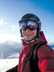 Selfie photo of Powder Matt in his ski gear on a sunny, blue sky day on the Kootenay Mountains of B.C.