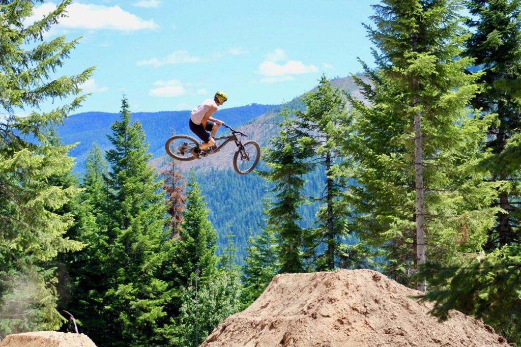 Mountain biker getting big air off a jump at SVR Bike Park in Wallace, Idaho.