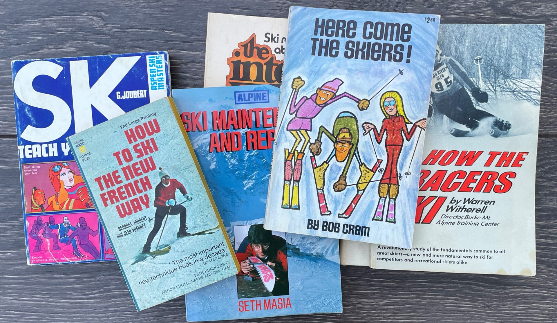 A collection of six vintage ski instruction, how-to guidebooks.