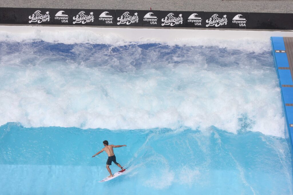 Man surfing a wave, Lakeside Surf, at Slidewaters Waterpark in Chelan, Washington.