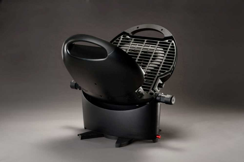 NomadiQ brand compact, portable grill -- black with base and vertical grill top.