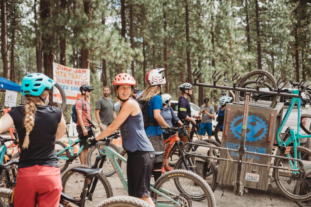 Woman ready to ride a mountain bike from the demo bike area at Spokatopia.