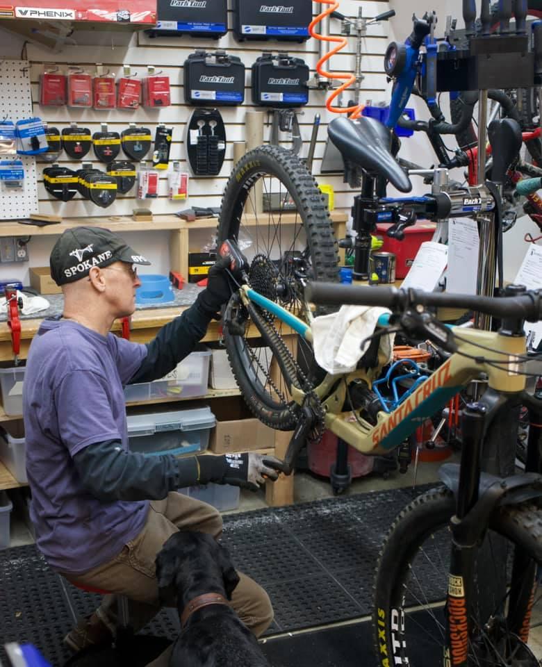 Mathew Larsen keeping things rolling at the Rambleraven Gear Trader bike shop.
