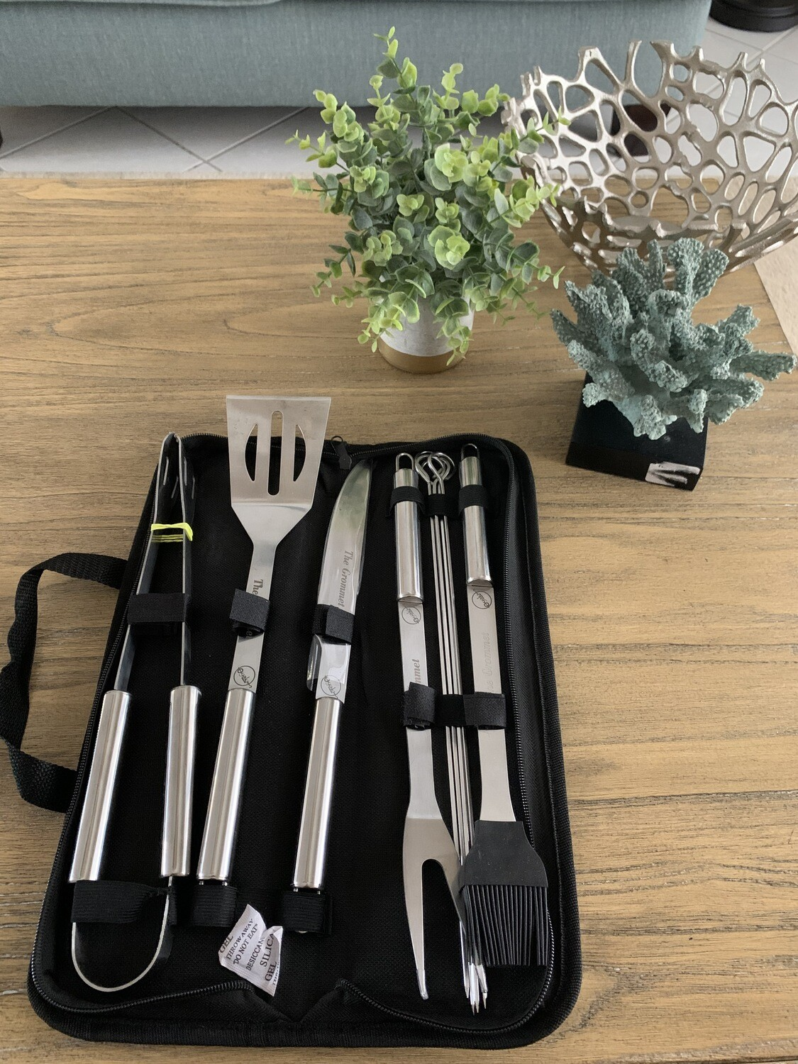 O-Yaki Grilling stainless steel accessories, including skewer, tons, and spatula, in a black carry-case.