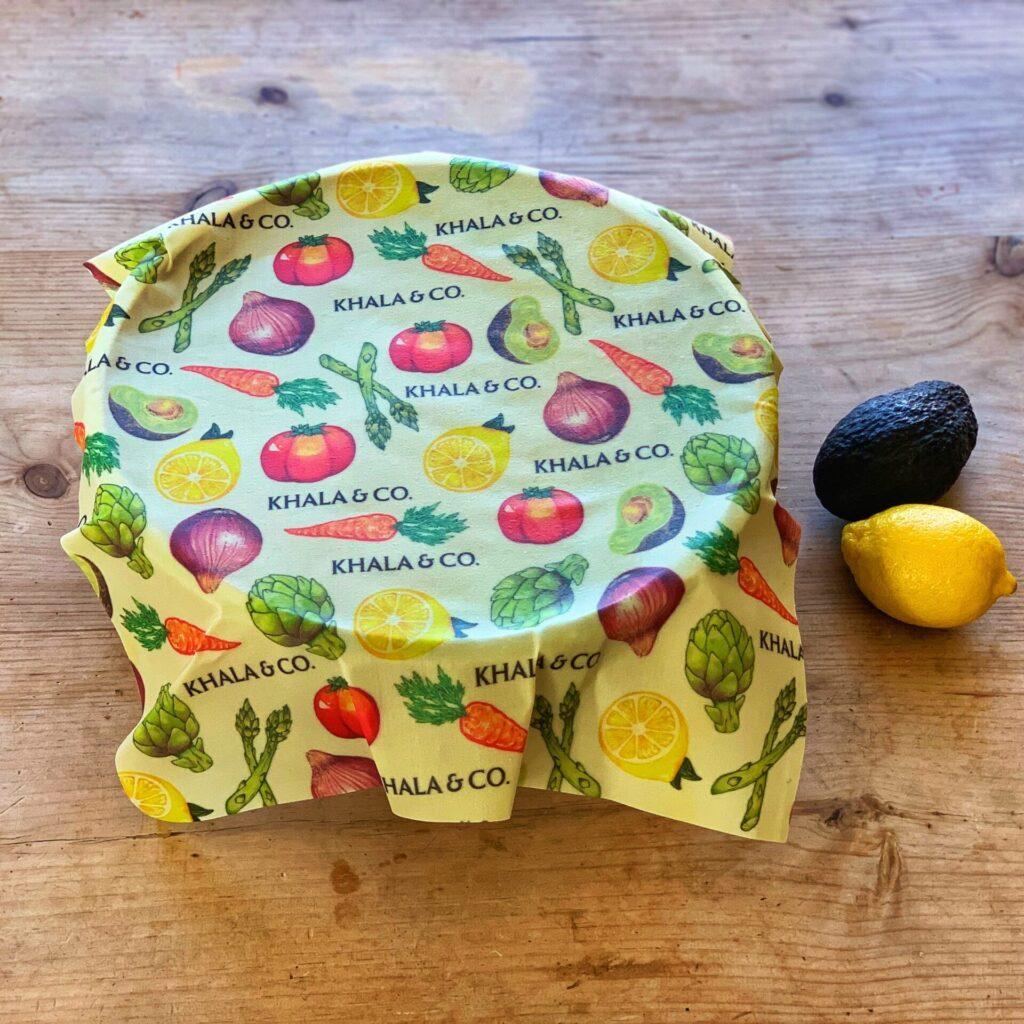 Khala & Company brand reusable food storage wrap -- yellow and vegetable pattern fabric.