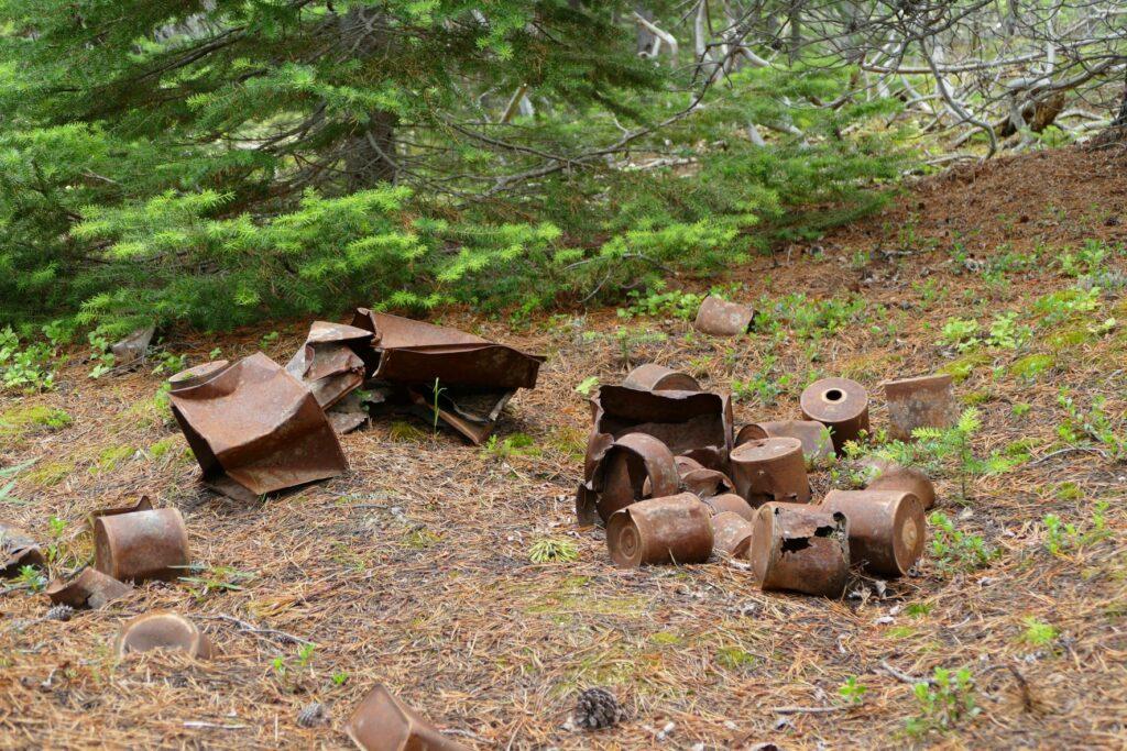 Rusted metal trash left behind on public lands.