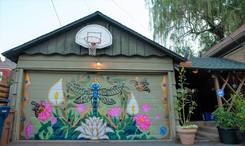 Flower mural art on a garage door.