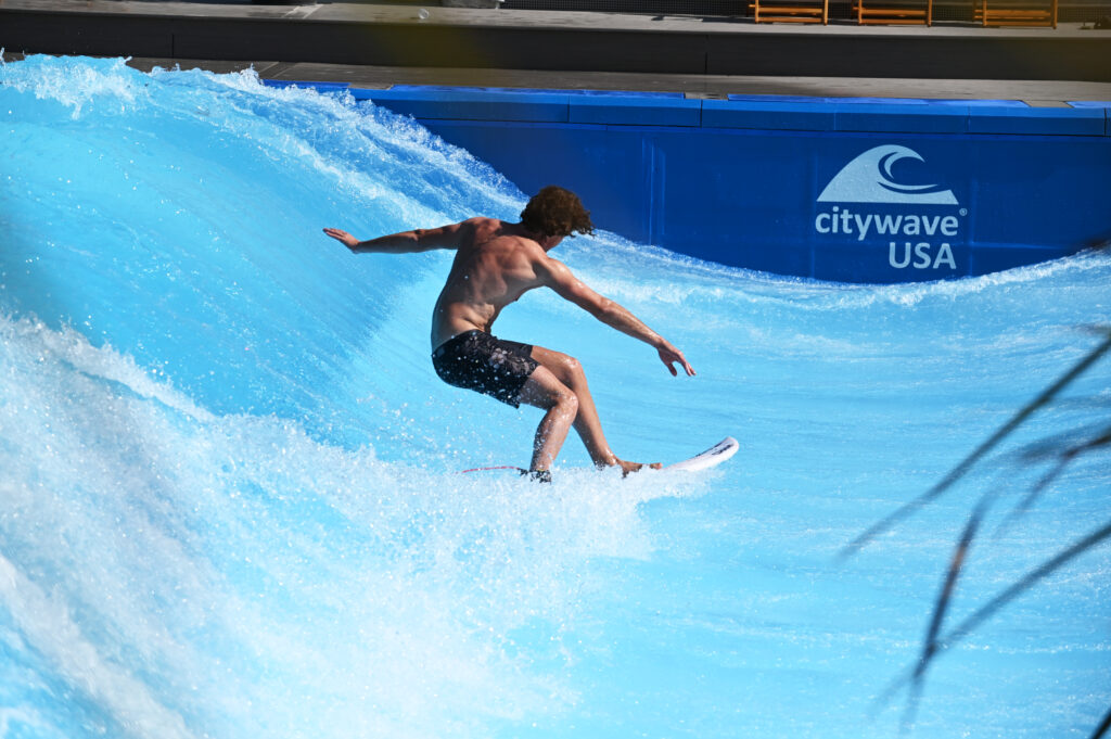 Man surfing a wave at Lakeside Surf at Slidewaters Water Park in Chelan, Washington.