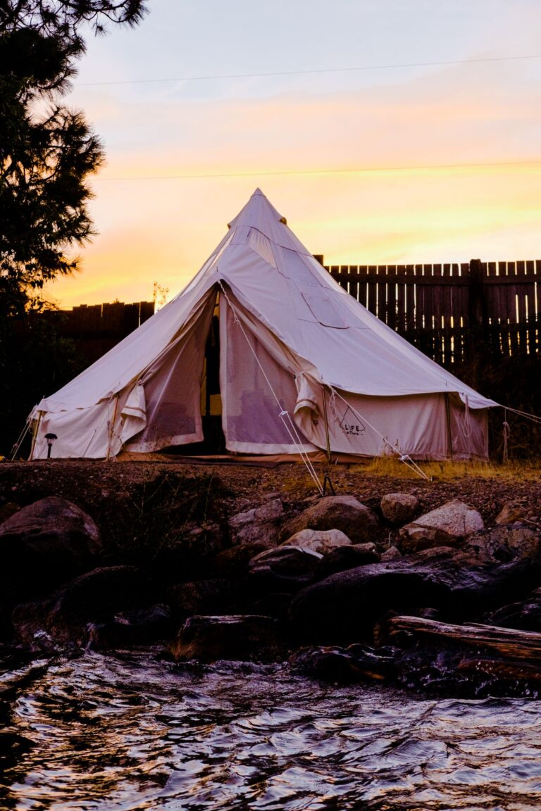 Large white canvas glamping tent on Lake Pend Oreille.