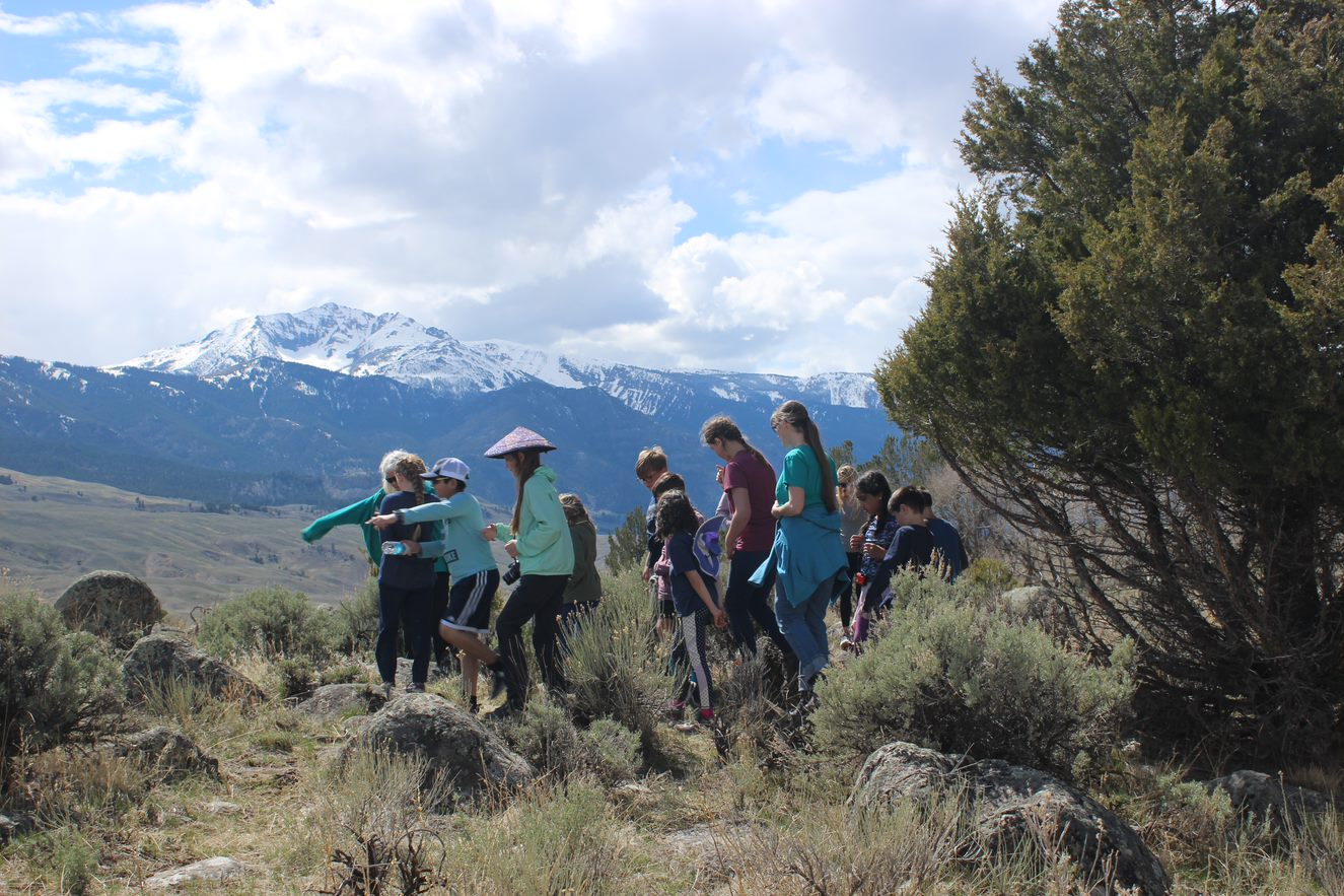 Elementary students learning and exploring at Yellowstone National Park.